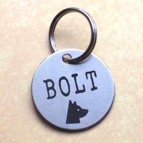 Ocelová psí známka s gravírováním jména a obrázku psa a tel. čísla na druhou stranu